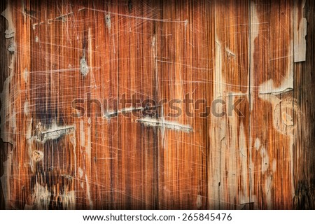 Photograph of obsolete old, varnished, weathered Wooden Laminated Panel, cracked, scratched, vignette grunge texture. - stock photo