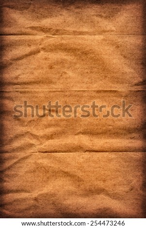 Photograph of old Recycle Kraft Brown Paper, coarse grain, crushed crumpled, vignette grunge texture sample.