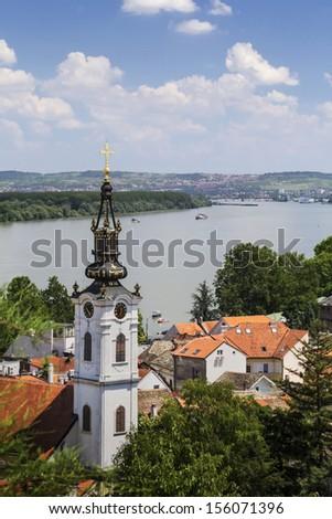 Photograph of panoramic view from Gardos - Zemun, with Saint Nicholas church baroque bell tower and river Danube. Zemun, Belgrade, Republic of Serbia. - stock photo