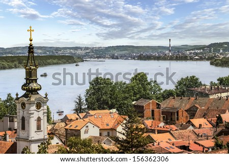 Photograph of panoramic view from Gardos - Zemun, with Saint Nicholas church baroque bell tower and river Danube. Zemun, Belgrade, Republic of Serbia. - stock photo