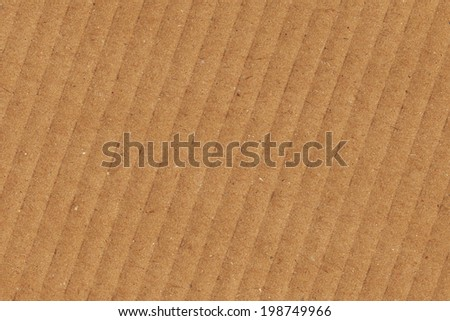 Photograph of recycle brown corrugated, coarse grain, striped cardboard, grunge texture sample