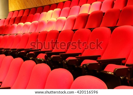 Photograph of some empty red theater seats