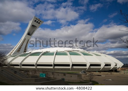 Photograph of the Montreal Olympic Stadium at daylight.  Check out images from the same angle taken at nigh or during a storm. - stock photo