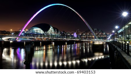 Photograph of the Quayside at Newcastle/Gateshead taken at night time. - stock photo