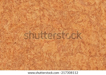Photograph of vivid Red Ocher recycle paper, extra coarse grain, mottled grunge texture sample. - stock photo
