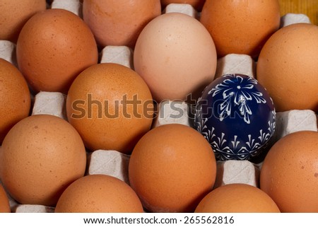 Photograph symbolizing individuality or 'stand out from crowd' concept. Image can be also used for Easter. - stock photo