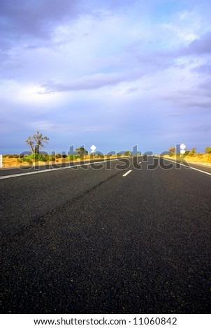 Photograph taken on the Sturt Highway in the Mallee Desert under a stormy sky (South Australia). - stock photo