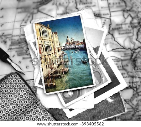 photograph with selective color  from the Grand Canal of Venice with the famous landmark cathedral Santa Maria della Salute laying on a desk with several images and a journal with pencil - stock photo