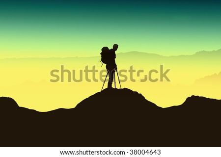 Photographer and landscape - stock photo