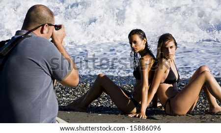 Photographer and models in summer photoshooting - stock photo