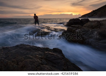 Photographer and streak wave views of the beach at sunset . With beautiful sunset at beach Thailand.Seascape during sunset. Beautiful natural seascape. Very soft seascape. - stock photo