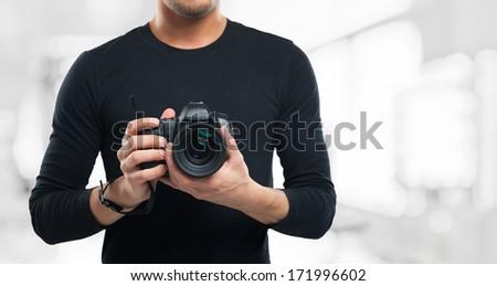 Photographer holding a digital camera - stock photo