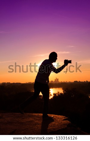 Photographer in back light - stock photo