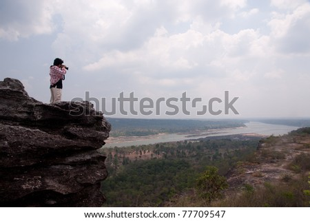 Photographer is on the cliff