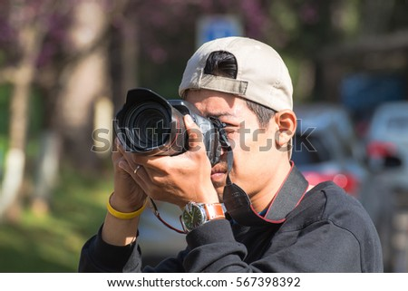 Photographer is taking a picture of nature on tour,travel trip