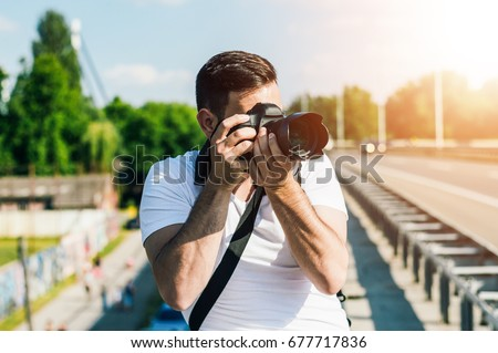 Photographer is taking photo on the road.