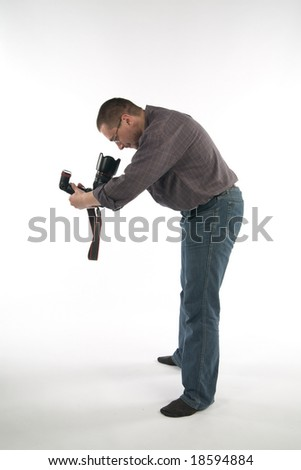Photographer looking into camera lens