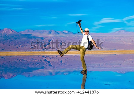 Photographer on a exotic place in Atacama Desert, Chile - stock photo