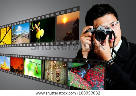 Photographer on using camera take pictures - stock photo