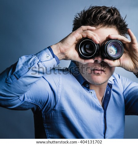Photographer's Vision Concept. Man Looking Through Lenses in Studio