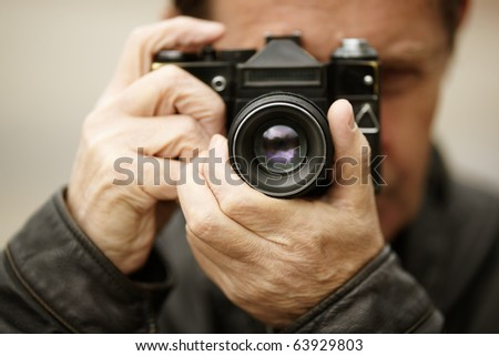 Photographer , selective focus on nearest part of the lens - stock photo