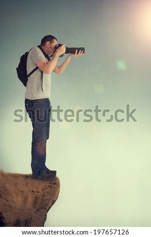 photographer shooting from a high vantage point - stock photo