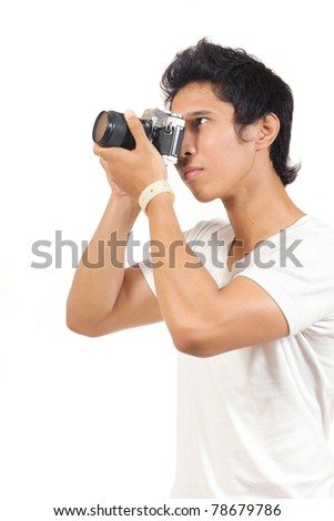 photographer shooting something with his camera - stock photo