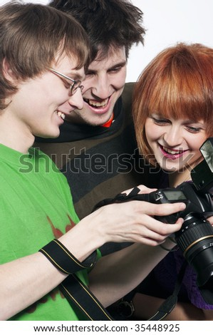 Photographer showing models image on the back of his digital slr. - stock photo