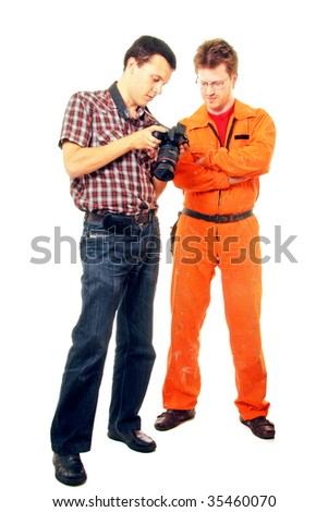 photographer shows shots on slr camera to model - worker - stock photo