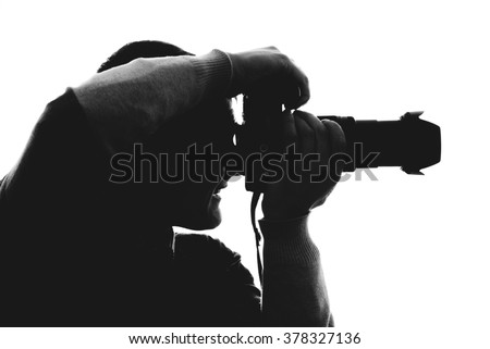 Photographer silhouette isolated on white background - stock photo