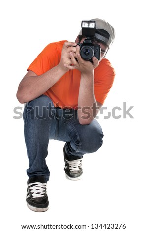 photographer squatting on white background - stock photo