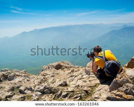 Photographer take a picture on a nature - stock photo