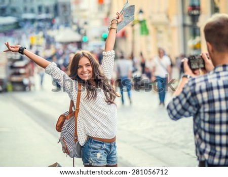 Photographer takes pictures of a young girl - stock photo
