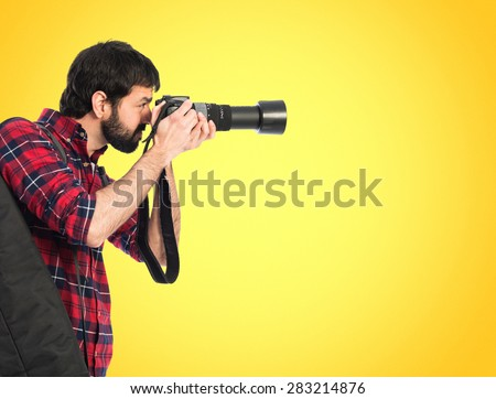 Photographer taking a photo over colorful background