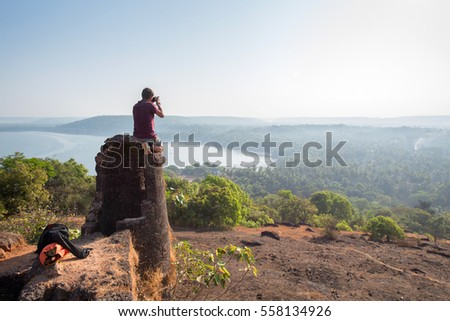 photographer taking a picture of the landscape