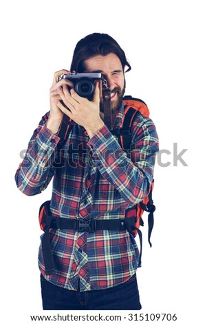 Photographer taking picture with camera against white background