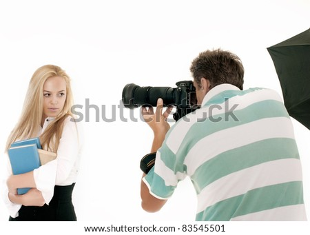 Photographer Taking Pictures of a Model in the Studio. It is not isolated - stock photo