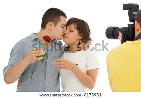 Photographer trying to capture the essence of love - isolated - stock photo
