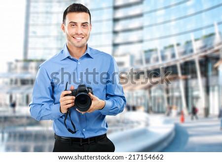 Photographer using his camera - stock photo