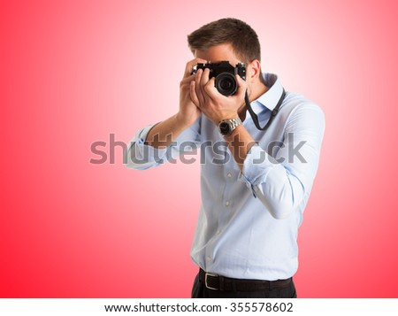 Photographer using his camera - stock photo