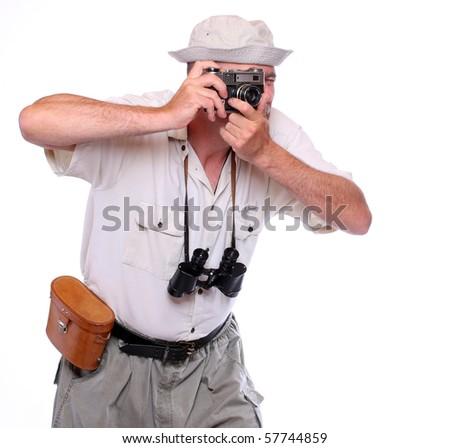 Photographer with camera dressed on safari suit Studio shot isolated on white - stock photo