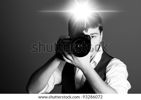 Photographer with camera in studio