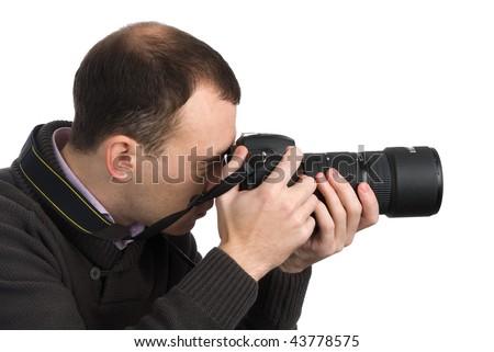 Photographer with camera isolated on white background - stock photo