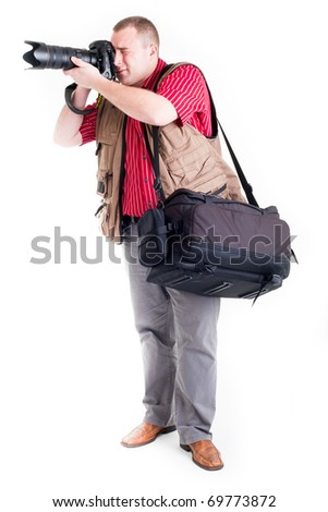 Photographer with digital camera and zoom lens on white background - stock photo