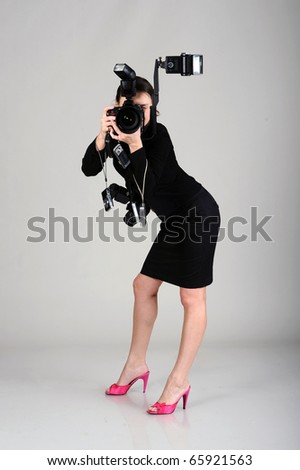 photographer with professional dslr camera, isolated on grey. may be use for professional photographer concept - stock photo