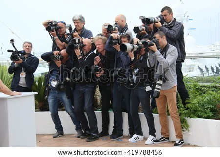 Photographers attends the 'Cafe Society' Photocall during The 69th Annual Cannes Film Festival on May 11, 2016 in Cannes, France. - stock photo