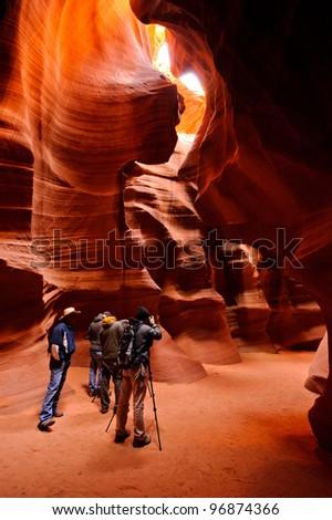 Photographers in Antelope canyon - stock photo