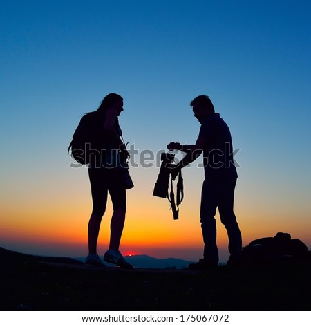 photographers outdoor at sunset - stock photo