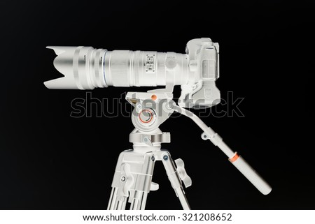 Photographic equipment / Negative camera with lenss on tripod - stock photo