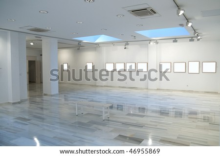 photographic exhibition with blank spaces in the frames - stock photo